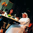 Meeting of Arab businesspeople in a cafe