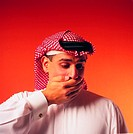 Arab man covering his mouth