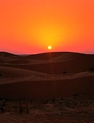 Orange sky at sunset over the desert