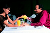 Amorous couple in a restaurant (thumbnail)