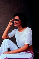Smiling woman on cell phone (thumbnail)