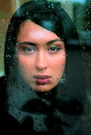 Arab woman behind a window