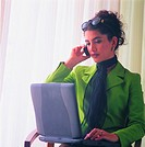 Arab businesswoman using laptop and mobile phone
