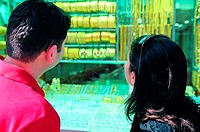Western couple looking at Jewellery display in the Gold Souq in Dubai, United Arab Emirates