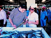 Tourists on the fish market in Dubai, United Arab Emirates
