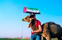 Tourist hugging a camel, United Arab Emirates