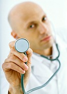 Doctor holding up stethoscope