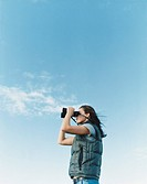 Woman Looking Through a Pair of Binoculars