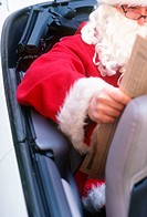 santa claus reading newspaper in a cabriolet car