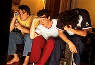 young men sitting on sofa´, despairing