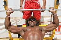 Black male bodybuilder weightlifting. Sport and Fitness Festival. Lummus Park. Miami Beach. Florida. USA.