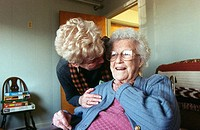 Woman visits her mother in nursing home. Pennsylvania, USA