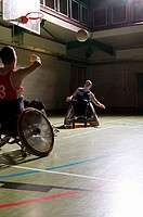 Disabled men playing basketball