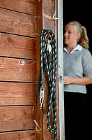 Young woman at stable door (thumbnail)