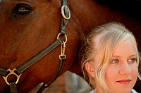 Young woman and her horse (thumbnail)