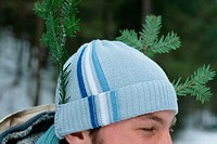 Man with pieces of tree in his hat (thumbnail)