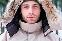 Man in a coat with furry hood