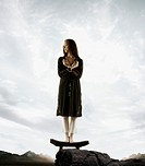 Full length portrait of woman on stool