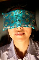 Close up of woman with sleep mask over her eyes