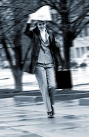 Businesswoman walking in the rain