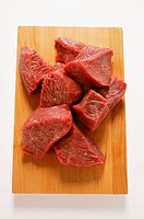 Diced beef on chopping board