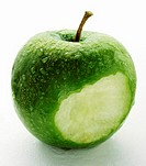 A Bitten Granny Smith Apple