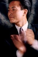 Close-up of a businessman clapping (thumbnail)