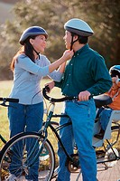 Parents with their son wearing cycling helmets