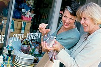 Two mature women shopping in a store