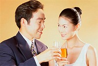 Close-up of a young couple toasting