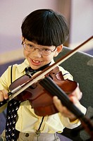 Portrait of a boy playing a violin