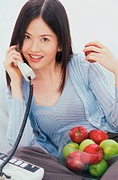 Portrait of a young woman talking on a telephone