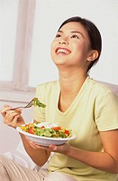 Young woman holding a bowl of salad