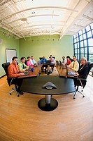 Portrait of a group of business executives sitting in a conference room