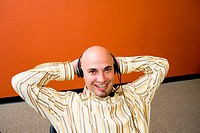 Portrait of a male customer service representative wearing a headset