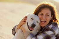 Mid adult woman hugging her dog
