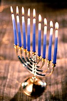 Close-up of lit candles on a menorah (thumbnail)