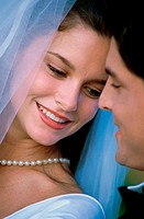 Close-up of a newlywed couple smiling