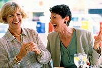 Two mature women sitting in a restaurant