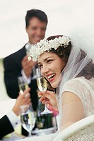 Bride toasting with glasses of champagne