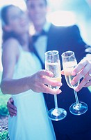 Newlywed couple toasting with glasses of champagne