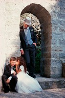 Flower girl whispering to ring bearer