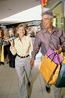 Mature couple carrying shopping bags