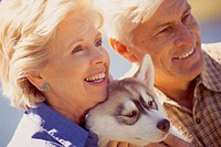 Close-up of a senior couple with their dog