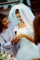 Newlywed young woman with her mother