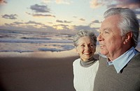 Side profile of a senior couple standing on the beach