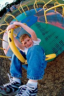 Portrait of a boy on a merry-go-round