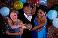 High angle view of two young women with a young man at a party