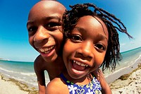 Portrait of a boy and a girl playing on the beach