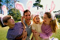 Parents and their son and daughter wearing pink bunny ears
